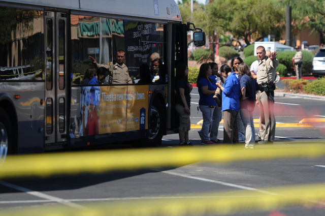 Walmart employees are directed to leave the scene near Walmart at Nellis Boulevard and Stewart Avenue in Las Vegas where two shooting suspects are confirmed deceased after shooting two police offi ...