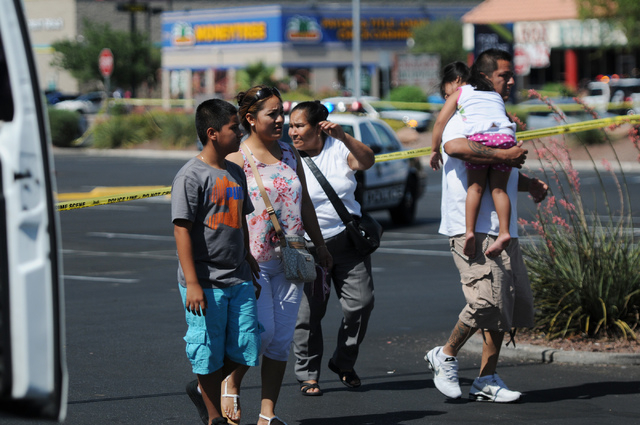 Witnesses from right, Cesar Fonseca, his daughter Amairany, 3, stepson Agustin, 12, his wife Maribel Garcia and mother-in-law Maria Campa, leave the scene at Walmart near Nellis Boulevard and Stew ...