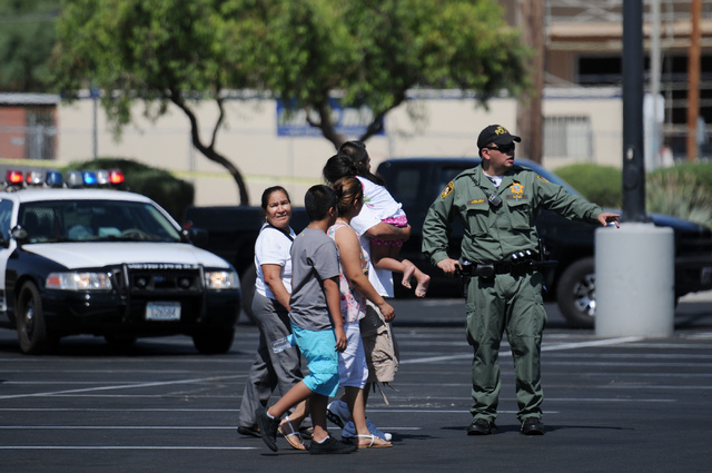 Witnesses leave the scene at Walmart near Nellis Boulevard and Stewart Avenue in Las Vegas after giving their statements to the Las Vegas Police Department on the shooting inside Walmart Sunday, J ...