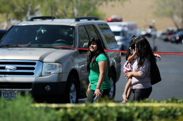 Witnesses Sandra Chavez, right, leaves the scene with her daughters Naraly, 3, and Alexandra, 12, at Walmart near Nellis Boulevard and Stewart Avenue in Las Vegas after giving their statements to  ...