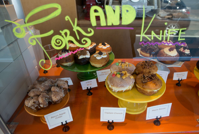 A variety of doughnuts at O Face Doughnuts, located inside the rehabbed John E. Carson Hotel building at 124 S. Sixth St., are photographed Thursday, June 19, 2014. The new shop, which opened in A ...