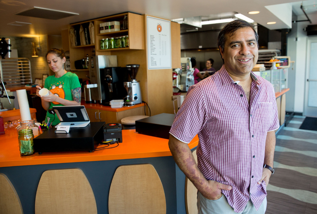 O Face Doughnuts owner Sonny Ahuja (cq), poses inside the doughnut shop, located inside the rehabbed John E. Carson Hotel building at 124 S. Sixth St., on Thursday, June 19, 2014. The new shop, wh ...