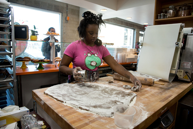 Angelika Johnson makes old-fashioned chocolate doughnuts at O Face Doughnuts, located inside the rehabbed John E. Carson Hotel building at 124 S. Sixth St., on Thursday, June 19, 2014. The new sho ...