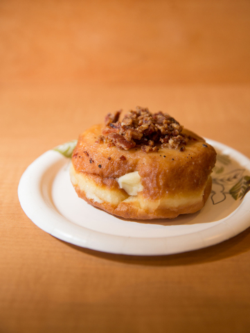 A maple bacon doughnut is photographed at the newly opened O Face Doughnuts, located inside the rehabbed John E. Carson Hotel building at 124 S. Sixth St., on Thursday, June 19, 2014. The shop ser ...