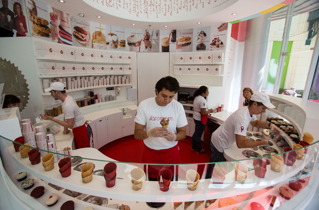 Brandon Padilla, center, makes an ice cream cone at Sprinkles, located in The Linq, Thursday, June 19, 2014. The cupcake and ice cream shop opened in March, making the Las Vegas location the 15th  ...