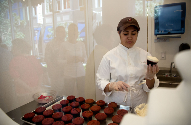 Maday Rodriguez frosts red velvet cupcakes at Sprinkles, located in The Linq, Thursday, June 19, 2014. The cupcake and ice cream shop opened in March, making the Las Vegas location the 15th store  ...