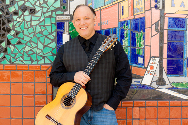 Classical guitarist Michael Nigro will salute Latin American composers at two free concerts this weekend at local libraries. (Courtesy photo)