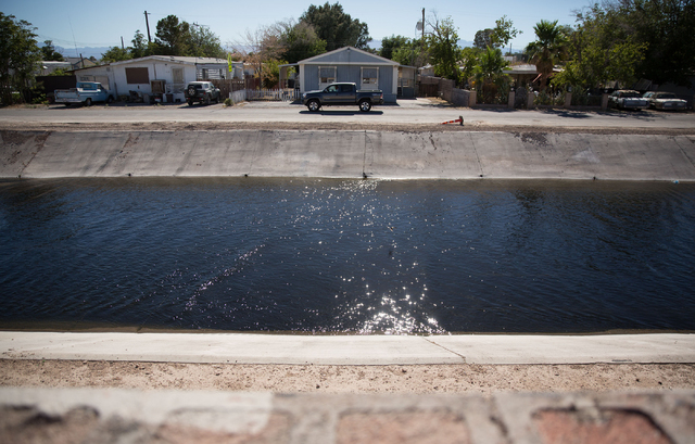 A truck drives on North Sloan Lane alongside Sloan Channel in North Las Vegas on Friday, June 27, 2014. A pipeline to carry wastewater from the North Las Vegas Water Reclamation Facility along the ...