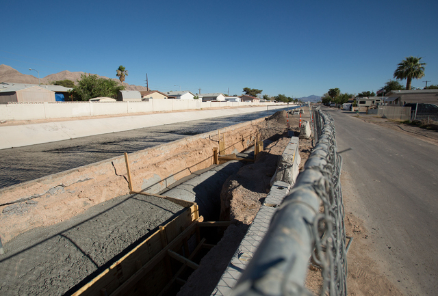 A pipeline runs alongside Sloan Channel near Carey Avenue and North Sloan Lane in North Las Vegas on Friday, June 27, 2014. (Samantha Clemens-Kerbs/Las Vegas Review-Journal)