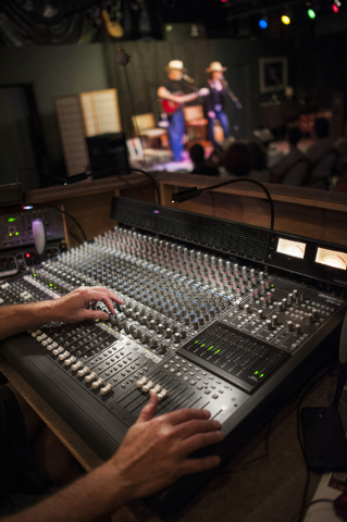 Dan Dalewatz works the sound board during GarageMaHall in Las Vegas on Saturday, May 24, 2014. The event takes place at the home of Richard and Betty Stewart and features traveling musicians the c ...