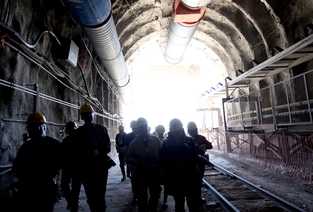 Members of the U.S. House Energy and Commerce Subcommittee on Environment and Economy are accompanied by their staff as the take a tour of the Yucca Mountain nuclear waste repository on April 26,  ...