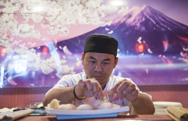 Steve Wei makes sushi at Ohjah Japanese Steakhouse in Las Vegas on Saturday, May 24, 2014. The restaurant has been open for over two years and features sushi and hibachi. (Jacob Kepler/Las Vegas R ...