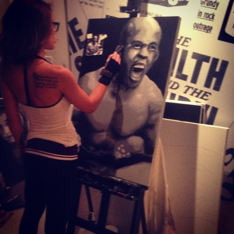 Octagon Girl Brittney Palmer, based in Los Angeles, works on her artwork that will be part of an art show that will be part of UFC's International Fight Week from July 1-6. (Courtesy UFC)
