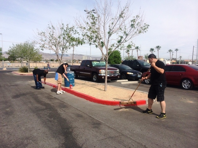 Volunteers from the Nevada Beverage Company and community members participate during a Las Vegas park beautification project coordinated by Keep Las Vegas Beautiful at Ed Fountain Park, 1400 N. De ...
