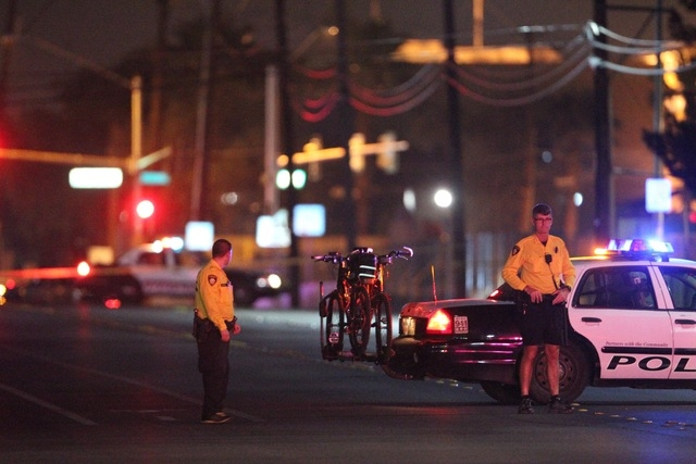 Police are present at the apartment of the Metro shooting suspects. (Kevin Cannon/Las Vegas Review-Journal)