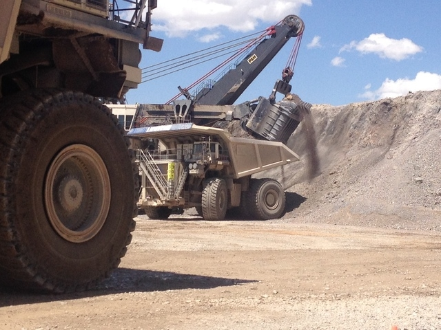 A $30 million shovel at the Cortez Mine loads a bucket of dirt into a two-story tall dump truck in one of two open pit operations at the site 70 miles southwest of Elko. (Sean Whaley/Las Vegas Rev ...