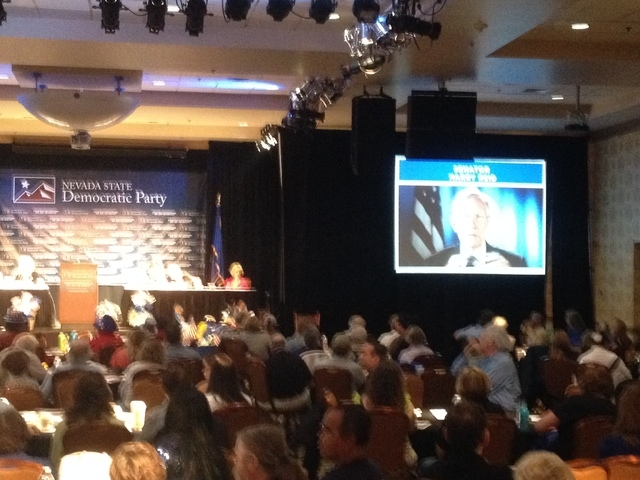 Harry Reid addresses the delegates via video at the Reno Democratic convention. (Whip Villarreal, Las Vegas Review-Journal)