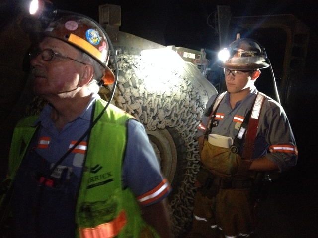 John Taule, general supervisor of the underground mine operation, left, and Matt Wilson, underground engineer, look over the previous day's blasting at the Cortez Hills mine 70 miles southwest of  ...