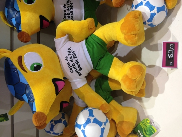Karle strolled through the FIFA merchandise tent, which was immense and had a huge assortment of souvenirs, jerseys, hats, soccer balls, and a billion items with the official FIFA mascot Juleco th ...