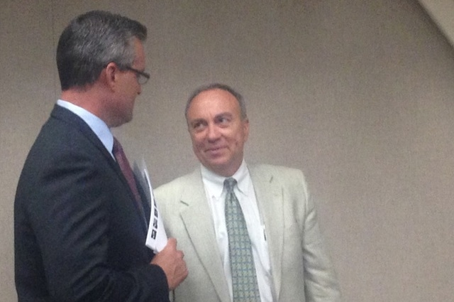 Dan Pentkowski, president of Henderson Professional Fire Fighters association, and assistant city manager Fred Horvath talk before Tuesday's City Council meeting discussing the new fire department ...
