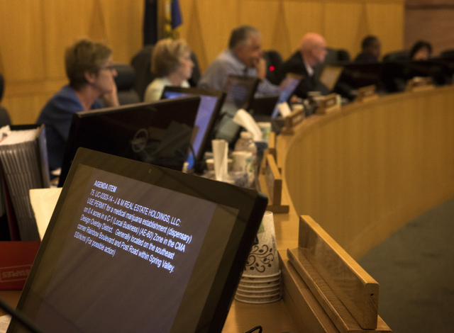 Clark County Commissioners listen during final day of presentations from applicants seeking medical marijuana dispensary permits at Clark County Government Center on Friday, June 6, 2014. The coun ...