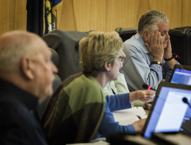 Clark County Commission Chairman Steve Sisolakl, right, listens during final day of presentations from applicants seeking medical marijuana dispensary permits at the Clark County Government Center ...