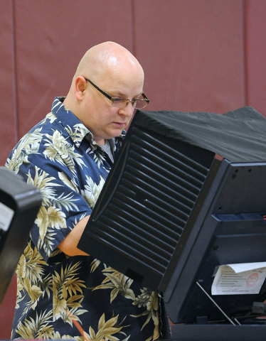 Christiaan Barnard votes at a polling place at Cimarron-Memorial High School in Las Vegas, Tuesday, June 10, 2014. (Jerry Henkel/Las Vegas Review-Journal)