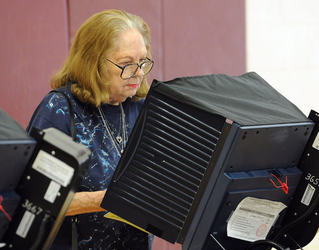 Verlene Wheeler votes at the polling place at Cimarron-Memorial High School in Las Vegas, Tuesday, June 10, 2014. (Jerry Henkel/Las Vegas Review-Journal)