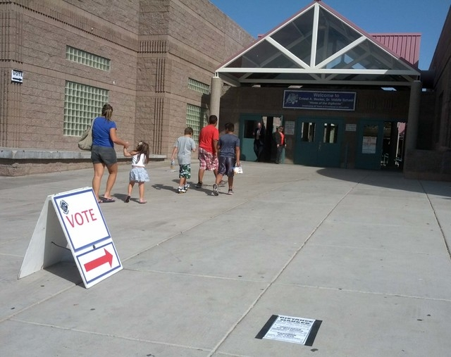 People are seen at a polling place at Earnest Becker Middle School, 9151 Pinewood Hills Drive, on Tuesday, June 10, 2014, in Las Vegas. Voters are casting ballots in Nevada's primary election. (Da ...