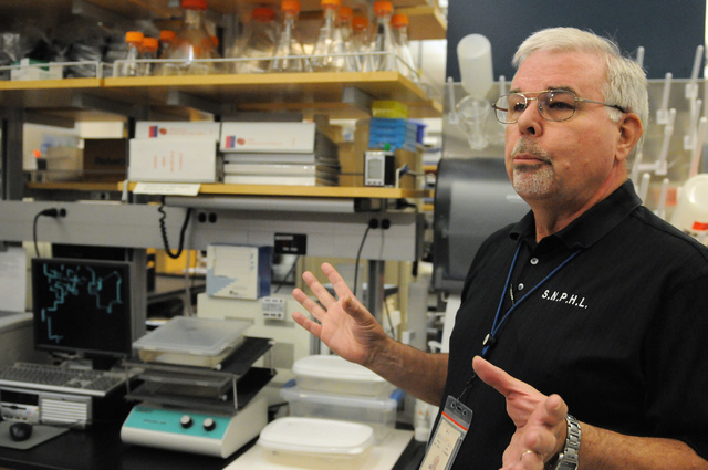 Microbiologist Paul Hug at Southern Nevada Public Health Laboratory in Las Vegas speaks during their facility's first media tour after 10 years of operation Wednesday, June 11, 2014. (Erik Verduzc ...