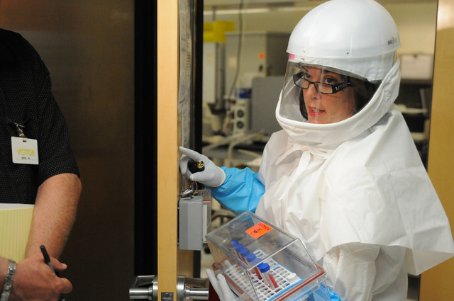 Betsy Sapp, laboratory assistant at Southern Nevada Public Health Laboratory in Las Vegas, returns to her work station during the facility's first media tour after 10 years of operation Wednesday, ...