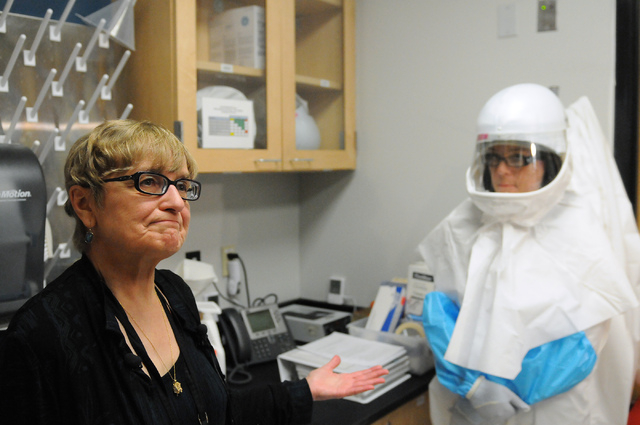 Pat Armour, left, laboratory manager at at Southern Nevada Public Health Laboratory in Las Vegas, introduces laboratory assistant Betsy Sapp during the facility's first media tour after 10 years o ...