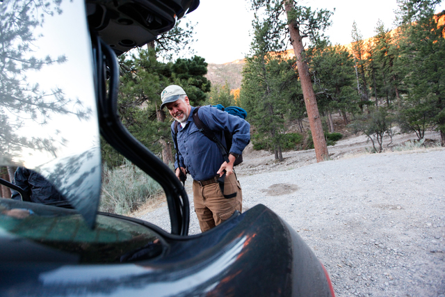 Fred Bell dons a backpack holding some of his sound recording equipment before hiking up Fletcher Canyon at Mount Charleston on Thursday, June 19, 2014. Bell goes to various areas to record the so ...