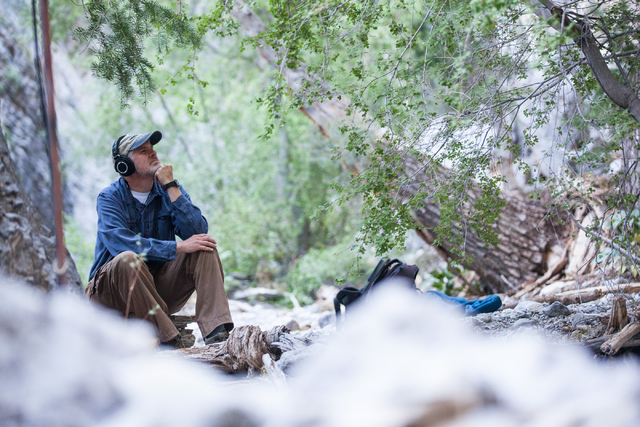 Fred Bell listens to the sounds of nature through his recording equipment in Fletcher Canyon at Mount Charleston on Thursday, June 19, 2014. Bell goes to various areas to record the sounds of natu ...