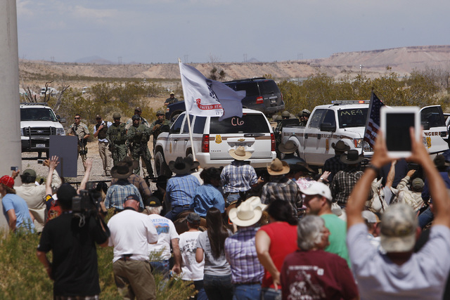 The Bundy family and their supporters gather together under the I-15 highway just outside of Bunkerville in order to confront the BLM and demand the release of their impounded cattle on April 12,  ...