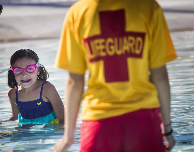 Lillian Ukauka, 4, during a swimming class at Wet'n'Wild Las Vegas on Friday, June 20, 2014. The theme park  participated in the world's largest simultaneous swimming lesson, which stands at 32,45 ...