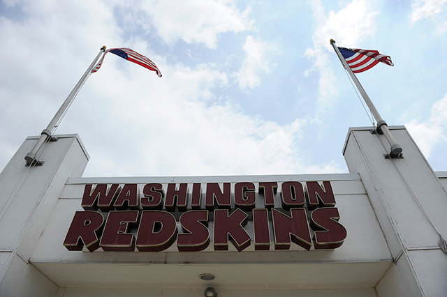 The Washington Redskins name is displayed on a building at their training facility at Redskins Park during NFL football minicamp, Wednesday, June 18, 2014, in Ashburn, Va. The U.S. Patent Office r ...