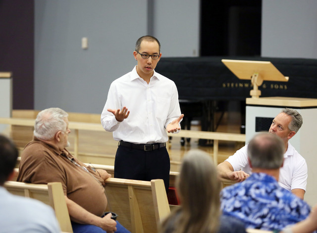 Robert Hoo leads a Nevadans for the Common Good meeting at Desert Springs United Methodist Church, located at 120 N. Pavilion Center Drive, Sunday, June 1, 2014, in Las Vegas. Nevadans for the Com ...