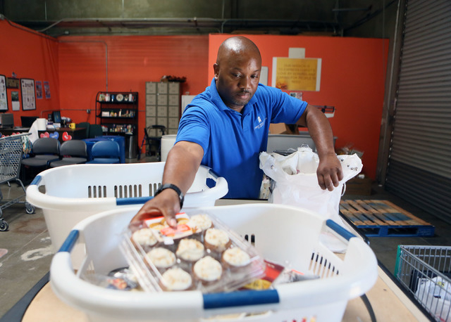 Pantry Supervisor Jeff Williams bags groceries at the Lutheran Social Services of Nevada's food pantry Friday, May 30, 2014, in Las Vegas. The Lutheran Social Services of Nevada offers several pro ...