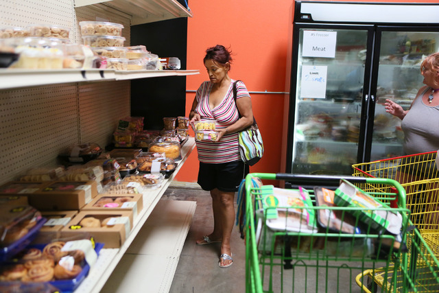 Ana Martinez, center, shops for groceries at the Lutheran Social Services of Nevada's food pantry Friday, May 30, 2014, in Las Vegas. The Lutheran Social Services of Nevada offers several programs ...