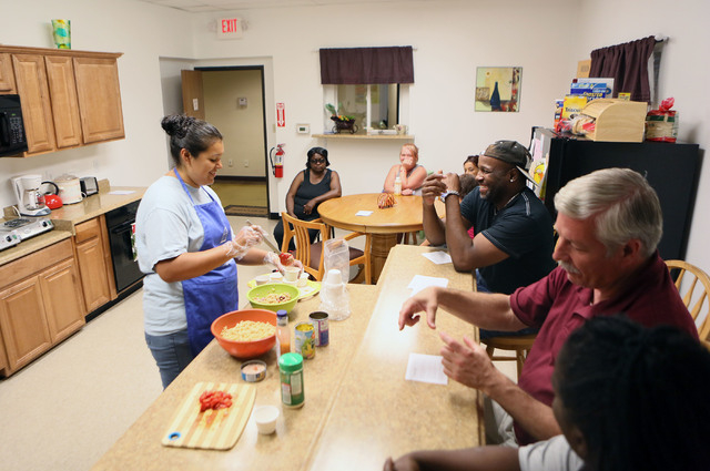 Marisa Cervantes (cq), left, Family Education Empowerment and Distribution program manager, prepares a whole wheat pasta salad during the Nutrition Education Class at the Lutheran Social Services  ...
