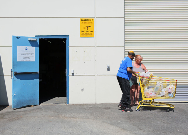Billy King, left, helps Victoria Murphy with her bags of groceries at the Lutheran Social Services of Nevada's food pantry Friday, May 30, 2014, in Las Vegas. The Lutheran Social Services of Nevad ...