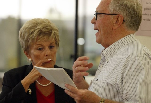 UNLV President Carol Harter and then-Chancellor Jim Rogers talk during a break at the Board of Regents meeting Thursday, Aug. 19, 2004 at the Truckee Meadows Community College in Reno, Nevada. Rev ...