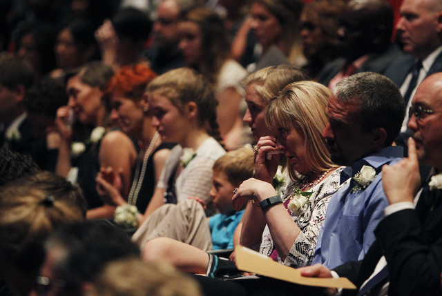 Kimberley Rogers, daughter of Jim Rogers, third from right, reacts to a speaker during the memorial service for her father, the late Jim Rogers, at Ham Concert Hall at UNLV in Las Vegas on Saturda ...