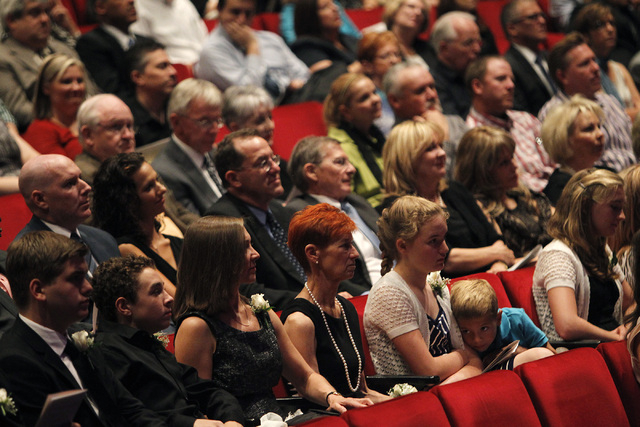 Wife Beverly Rogers, middle with red hair, sits among friends and family during the memorial service for her husband, the late Jim Rogers, at Ham Concert Hall at UNLV in Las Vegas on Saturday, Jun ...