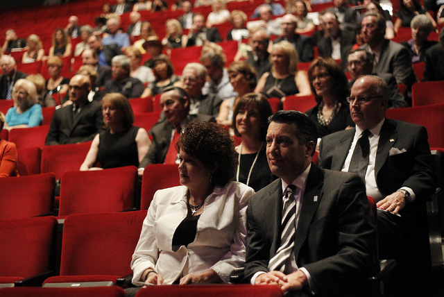 Nevada Governor Brian Sandoval and his wife Kathleen, front, attend the memorial service for the late Jim Rogers at Ham Concert Hall at UNLV in Las Vegas on Saturday, June 21, 2014. (Jason Bean/La ...