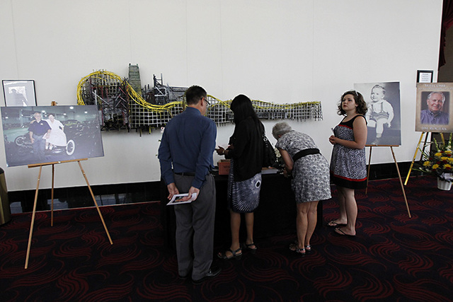 People gather before the start of the memorial service for the late Jim Rogers at Ham Concert Hall at UNLV in Las Vegas on Saturday, June 21, 2014. (Jason Bean/Las Vegas Review-Journal)