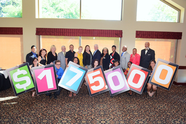 Seven of the first 16 Cox diversity scholarship award recipients stand with number signs that spell out the $175,000 that Cox Las Vegas pledged toward its diversity scholarship program over the ne ...