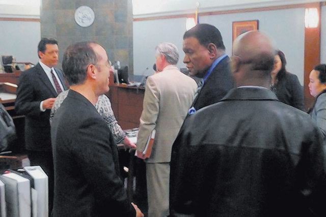 Jerry Seinfeld, left, speaks to friend and fellow comedian George Wallace in a Clark County courtroom back in March. Wallace sued the Bellagio, alleging his foot got entangled in loose electrical  ...
