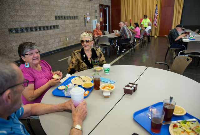 Mike and Lola Murtaugh (cq), bottom left, and Stacee Gross (cq) joke while eating lunch at the Heritage Park Senior Facility in Henderson on Friday, June 20, 2014.  In an effort to reduce taxpayer ...